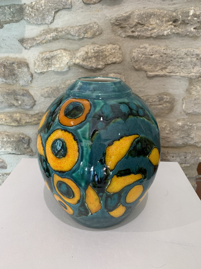 large green and yellow vase