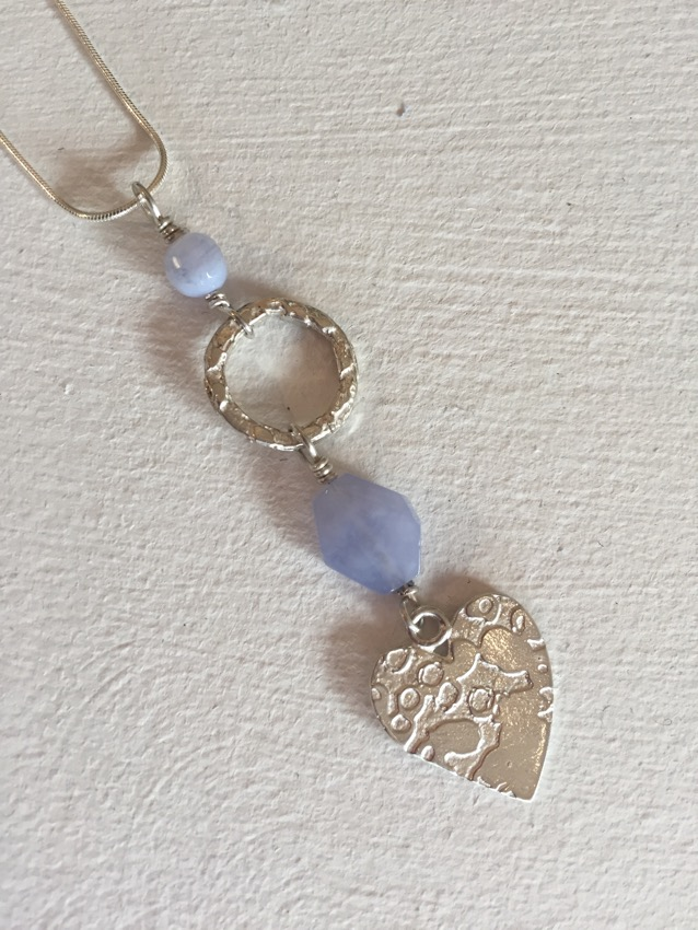 Large circle and heart pendant with lace blue agate